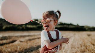 happy-kid-with-a-baloon-2021-07-24-17-02-00-utc